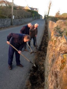 Marc van Dommelen, Paddy Clancy and Alan Britton tidying up road verges on the Killusty approach road.